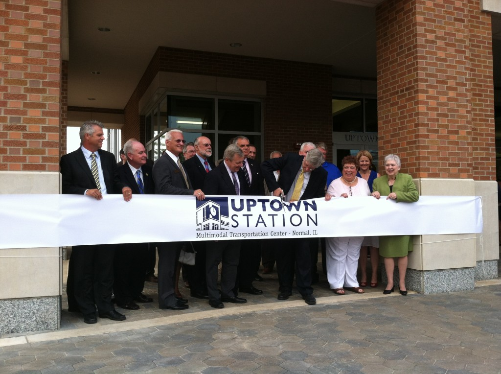 Mayor Koos cuts the ribbon on Uptown Station while accompanied by Transportation Secretary Ray LaHood (next on left) and Senator Dick Durbin (next on left). Sen Durbin was instrumental in supporting the project as well as repeatedly fighting to preserve funding for the TIGER grant program.